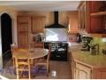 tailleur-de-pierre-cuisine-bois-plan-de-travail-pierre-calcaire-claire-naturelle